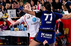 Tonje Larsen of Larvik  vs Andrea Lekic of Krim during 3rd Main Round of Women Champions League handball match between RK Krim Mercator, Ljubljana and Larvik HK, Norway on February 19, 2010 in Arena Kodeljevo, Ljubljana, Slovenia. Larvik defeated Krim 34-30. (Photo by Vid Ponikvar / Sportida)
