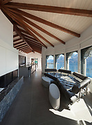 Interior of a loft, wide living room, leather divan
