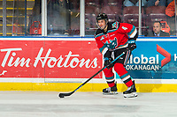 KELOWNA, CANADA - DECEMBER 7: Devin Steffler #4 of the Kelowna Rockets skates with the puck against the Victoria Royals  on December 7, 2018 at Prospera Place in Kelowna, British Columbia, Canada.  (Photo by Marissa Baecker/Shoot the Breeze)