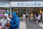 People shopping at Primark in the city centre shopping district in what was a positive atmosphere on the long awaited freedom day when all remaining coronavirus restrictions are lifted in the UK on 19th July 2021 in Birmingham, United Kingdom. While many people are wearing face masks, they are no longer mandatory, and the Primark queueing system has beeen removed, while government advice suggests that it is advised to wear a face covering in busy public places inside and on transport.