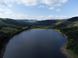 © Licensed to London News Pictures. 11/08/2021. Merthyr Tydfil, UK. Aerial view of the reservoir during today's sunshine. Mixed weather with sunshine for some and heavy showers in other areas. Photo credit: Andrew Bartlett/LNP