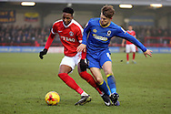 AFC Wimbledon midfielder Jake Reeves (8) battles for possesion with Charlton Athletic midfielder Joe Aribo (32) during the EFL Sky Bet League 1 match between AFC Wimbledon and Charlton Athletic at the Cherry Red Records Stadium, Kingston, England on 11 February 2017. Photo by Matthew Redman.