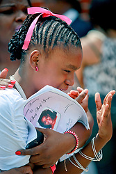 14 September 2013. Prayer Tower Church of God in Christ. New Orleans, Louisiana. <br /> Family members and friends mourn for 11 yr old Arabian 'Ray Ray' Gayles, fatally shot September 2nd. Arabian was cradling a 1 yr old cousin whilst sat on the couch at home when gunmen pulled up outside and sprayed the house with bullets. Arabian was hit in the head and died shortly afterwards. NOPD is questioning 2 men in connection with the murder.<br /> Photo; Charlie Varley
