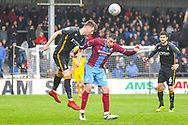 Paudie O'Connor of Bradford City (5) and Lee Novak of Scunthorpe United (17) in action during the EFL Sky Bet League 1 match between Scunthorpe United and Bradford City at Glanford Park, Scunthorpe, England on 27 April 2019.