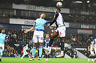West Bromwich Albion defender Semi Ajayi (6) heads the ball  under pressure from Derby County defender Curtis Davies (33) during the EFL Sky Bet Championship match between West Bromwich Albion and Derby County at The Hawthorns, West Bromwich, England on 14 September 2021.