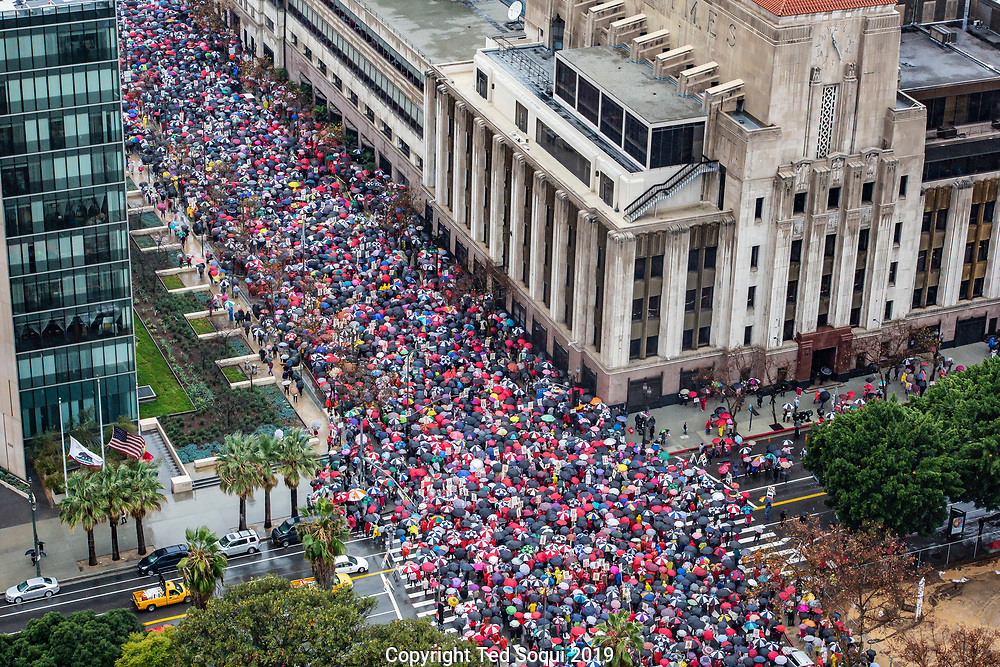 Thirty-thousand UTLA teachers walk off the job and march through rain soaked downtown Los Angeles. This is their first strike in thirty-years.