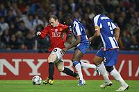 20090415: PORTO, PORTUGAL - FC Porto vs Manchester United: Champions League 2008/2009 Ð Quarter Finals Ð 2nd leg. In picture: Rooney and Cissokho. PHOTO: Ricardo Estudante/CITYFILES
