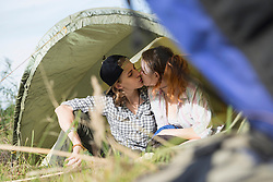 Young couple kissing in a camp, Bavaria, Germany