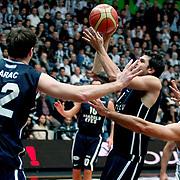 Anadolu Efes's Cenk Akyol (C) during their Turkish Basketball league derby match Besiktas between Anadolu Efes at the BJK Akatlar Arena in Istanbul Turkey on Saturday 31 December 2011. Photo by TURKPIX