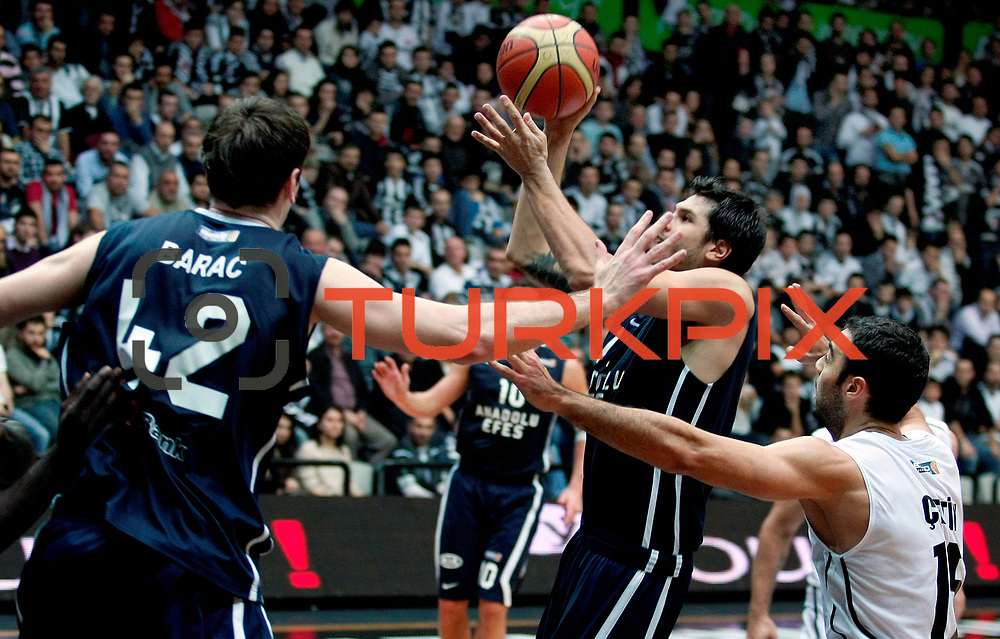 Anadolu Efes's Cenk Akyol (C) during their Turkish Basketball league derby match Besiktas between Anadolu Efes at the BJK Akatlar Arena in Istanbul Turkey on Saturday 31 December 2011. Photo by TURKPIX