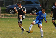 Fabian Lopez (#16) of Deportivo Colomex competes for control of the ball while competing with Team Shlama F.C. during National Soccer League play in Skokie, Il.  .
