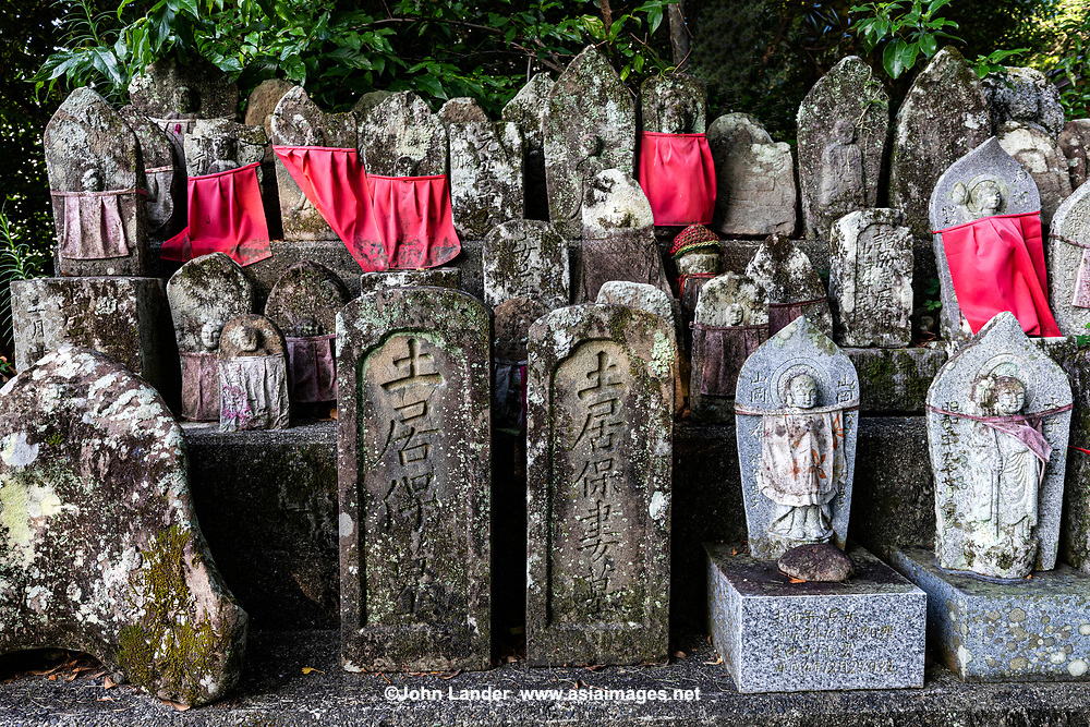 """Jizo at Sekkeiji i- Temple 33 on the Shikoku Pilgrimage and can be translated as, """"Snowy Cliff Temple"""". This temple is one of only three Zen temples on the Shikoku Pilgrimage. Legend has it that this place was home to a long-suffering ghost who woke up the monk, Geppou, saying """"Even the water is weary of living.""""  Geppou spoke to the apparition who was attempting to recall a poem from which these lines come. Once the poem was completed, the ghost disappeared having now been relieved of trying to recall the missing lines. In the 16th century it changed to a Rinzai Zen temple, now one of only three Zen temples on the pilgrimage."""