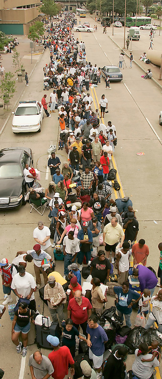 Thousands of people wait outside the Louisiana Superdome to be let in for shelter from Hurricane Katrina in New Orleans August 28, 2005. Authorities in New Orleans ordered hundreds of thousands of residents to flee on Sunday as Hurricane Katrina strengthened into a rare top-ranked storm and barreled towards the vulnerable U.S. Gulf Coast city. REUTERS/Rick Wilking