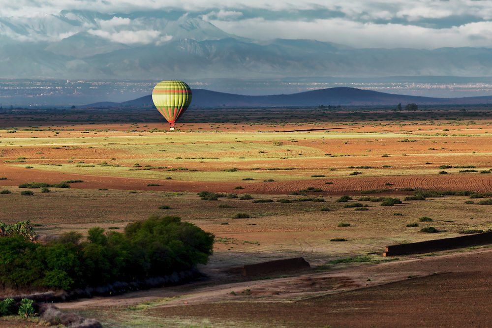 Hot-air balloon over rural Marrakech, Morocco.