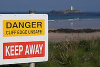 Warning signs along the cliffs at Godrevy, Cornwall