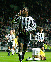 Photo. Jed Wee.<br /> Newcastle United v NAC Breda, UEFA Cup, St. James' Park, Newcastle. 24/09/2003.<br /> Newcastle's Titus Bramble (C) leads the celebrations as Alan Shearer (L) and Gary Speed share his joy.