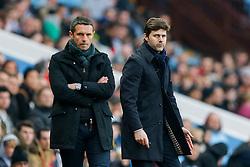 Tottenham Hotspur Manager Mauricio Pochettino looks on next to Aston Villa Manager Remi Garde - Mandatory byline: Rogan Thomson/JMP - 13/03/2016 - FOOTBALL - Villa Park Stadium - Birmingham, England - Aston Villa v Tottenham Hotspur - Barclays Premier League.
