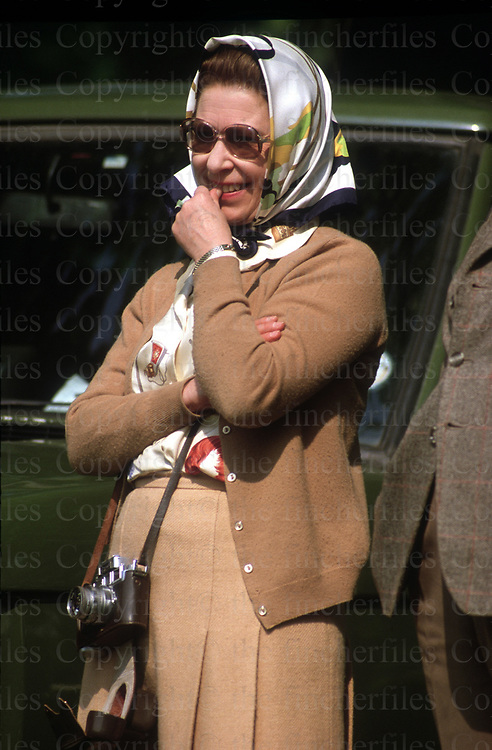 Queen Elizabeth seen at the Royal Windsor Horse Show in May 1982. Off- duty she takes her Leica camera to record the event. Photo by Jayne Fincher