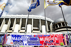 A commemorative scarf of the match is seen on display outside the grounds of the stadium before the match begins