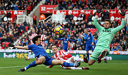 Leicester City's Shinji Okazaki (left) has a shot against Stoke City goalkeeper Jack Butland during the Premier League match at the bet365 Stadium, Stoke-on-Trent.