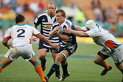 WP Nel of the Toyota Cheetahs goes in for the tackle on Nick Koster of the DHL Stormers with Ryno Barnes (Cheetahs) and Brok Harris (Stormers) in support during the Super Rugby (Super 15) fixture between the DHL Stormers and the Cheetahs held at DHL Newlands Stadium in Cape Town, South Africa on 26 February 2011. Photo by Jacques Rossouw/SPORTZPICS