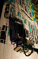 © Licensed to London News Pictures. 14/08/2012. Bristol, UK. Artists work at night on art in the See No Evil 2012 street art event, with artists from around the world creating new work on buildings in Nelson Street, Bristol.  It will be the biggest permanent street art installation in Europe.  The project launches on 16 and runs till 19 August, with a Block Party on 18 August. 14 August 2012..Photo credit: Simon Chapman/LNP