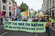 Extinction Rebellion climate activists take part in a colourful March for Nature on the final day of their two-week Impossible Rebellion on 4th September 2021 in London, United Kingdom. Extinction Rebellion are calling on the UK government to cease all new fossil fuel investment with immediate effect.