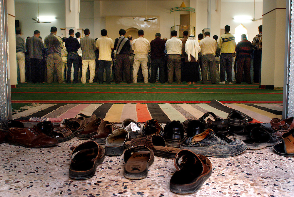 Muslim men of the village of Qaffin in the northern West Bank pray at a mosque in the center of town before breaking fast on November 23, 2003 during the holy month of Ramadan...Photo by Erin Lubin