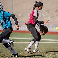Navajo Prep Eagle Elena Morris (2) sprints for second as the ball bounces to Shiprock Chieftain Danyel Johnson (2) Saturday at the Gallup Sports Complex.