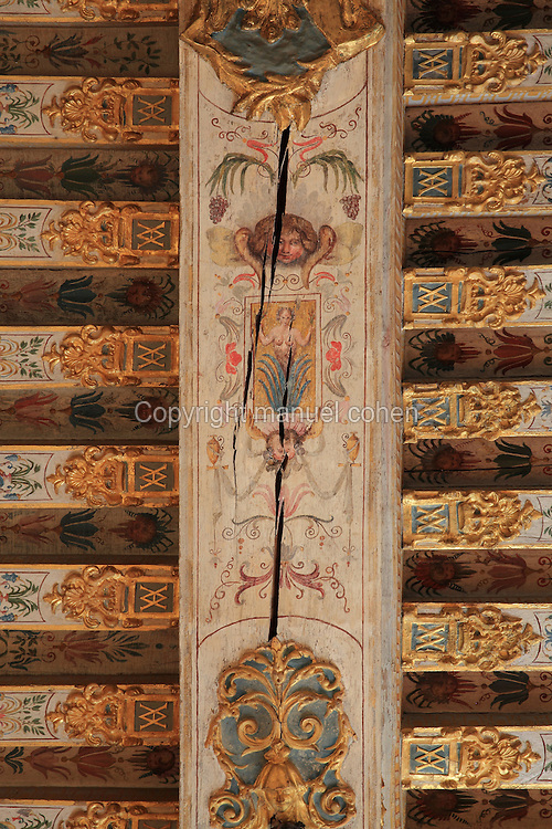 Painted decorative ceiling beams, with angel heads and floral decoration, 17th century, in the Guard Room, Chateau de Fontainebleau, France. The Guard Room is the first of the King's apartment and was occupied by the soldiers of the guard. The Palace of Fontainebleau is one of the largest French royal palaces and was begun in the early 16th century for Francois I. It was listed as a UNESCO World Heritage Site in 1981. Picture by Manuel Cohen