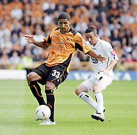 Photo:  Frances Leader.<br /> Wolverhampton Wanderers FC v Leeds United. The Coca-Cola Championship Molineux Stadium.<br /> 14/08/2004<br /> Wolves' Leon Clarke takes the ball away from Leeds' Gary Kelly.