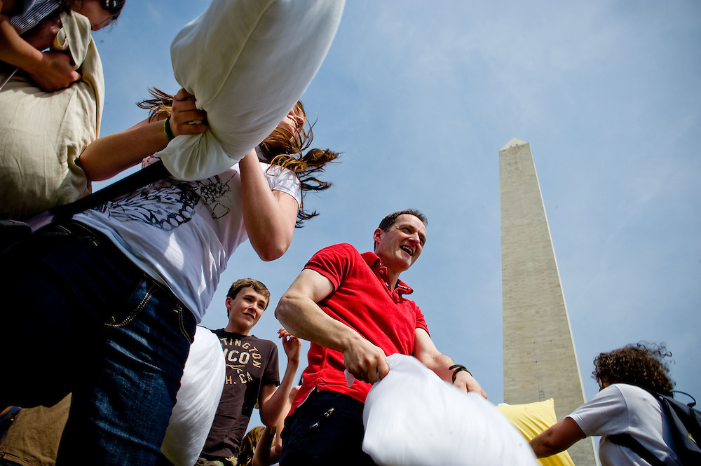A Facebook-coordinated pillow fight takes place on the National Mall near the Washington Monument on Saturday, April 3, 2010 in Washington.
