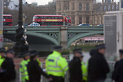 Police officers gather under the London Eye, locked-down after four people were killed including the attacker and 20 injured during a terrorist attack on Westminster Bridge and outside the Houses of Parliament, on 22nd March 2017, in central London, England. Parliament was in session and all MPs and staff and visitors were in lock-down while outside, the public and traffic were kept away from the area of Westminster Bridge and parliament Square, the scenes of the attack. It is believed a lone man crashed his car into pedestrians then, armed with a knife tried to enter Parliament, stabbing and killing a police officer at parliaments main gates.
