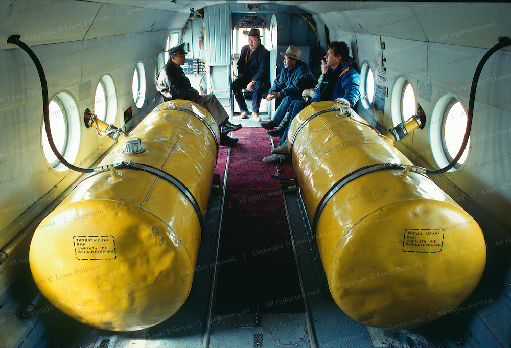 Two nine-thousand-liter (2,378 gal) auxiliary tanks leaking jet fuel onto a prayer rug occupied much of the interior of our helicopter, making it a potential flying Molotv cocktail because of our chainsmoking  pilots.  J. Knoebber far right.