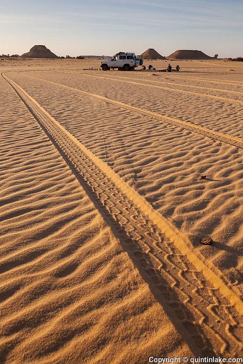 4X4 tracks in the sand and camp in the Western Desert, Egypt