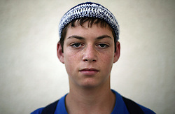 """Yona Tal, 13, a student and resident of the Gush Katif settlements, is seen in Gaza, Palestinian Territories, Nov. 4, 2004. When asked his thoughts about being forced to leave the settlements, he responded like a boy wise beyond his years, """"This is our hope and we cannot lose it. We will hold the Likud responsible and raise our voices against this decision."""" Israel's parliament recently supported compensation payments for Jewish settlers leaving the Gaza Strip, in a vital vote for Prime Minister Ariel Sharon's plan to evacuate the occupied territory."""