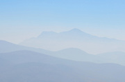 The misty blue mountains of the Sierra Norte seen from Monte Alban, Oaxaca, Mexico.