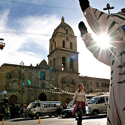 La Paz, Bolivia - March 27, 2008 - Luis Quispe Mamani, 19, gives the all clear to pedestrians in front of the Iglesia de San Francisco of La Paz on the Plaza Murillo...Photo by Susana Raab