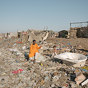 Garbage waste from the city has been used as landfill for development; a slum is built on top of the waste. Ibrahim Hyderi is a fisherman's village, once outside of Karachi, now part of the sprawling city and exposed to high level of pollution.