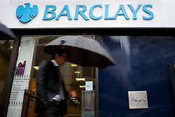 ***LNP BEST OF WEEK SELECTION*** © licensed to London News Pictures. London, UK 08/05/2014. People walking past a Barclays branch in central London on Thursday, 08 May 2014. Barclays is to cut 19,000 jobs by 2016 as part of a new strategy. Photo credit: Tolga Akmen/LNP
