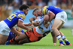 Leeds Rhinos' Josh Walters and Adam Cuthbertson tackle Castleford's Jake Websterduring the Betfred Super League match at the Mend-A-Hose-Jungle, Castleford.