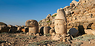 Statue heads, from right, Antiochus, & Eagle, with headless seated statues in front of the stone pyramid 62 BC Royal Tomb of King Antiochus I Theos of Commagene, east Terrace, Mount Nemrut or Nemrud Dagi summit, near Adıyaman, Turkey .<br /> <br /> If you prefer to buy from our ALAMY PHOTO LIBRARY  Collection visit : https://www.alamy.com/portfolio/paul-williams-funkystock/nemrutdagiancientstatues-turkey.html<br /> <br /> Visit our CLASSICAL WORLD HISTORIC SITES PHOTO COLLECTIONS for more photos to download or buy as wall art prints https://funkystock.photoshelter.com/gallery-collection/Classical-Era-Historic-Sites-Archaeological-Sites-Pictures-Images/C0000g4bSGiDL9rw