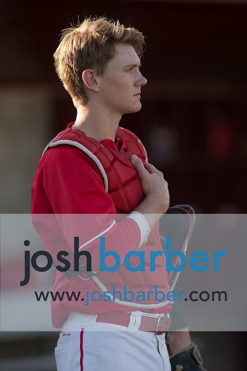Mater Dei's Blake Hunt (28) during the national anthem during a Trinity League game at Mater Dei High School on Friday, May 1, 2015 in Santa Ana, Calif. (Photo/Josh Barber)