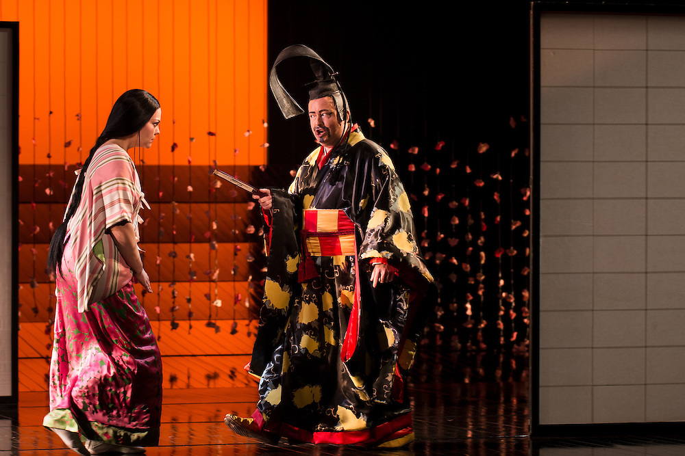 """LONDON, UK, 14 May, 2016. Rina Harms (left, as Butterfly) and Alun Rhys-Jenkins (as Goro) rehearse for the revival of director Anthony Minghella's production of Puccini's opera """"Madam Butterfly"""" at the London Coliseum for the English National Opera. The production opens on 16 May. Photo credit: Scott Rylander."""