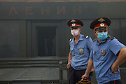 Moscow, Russia, 07/08/2010. .Militia wear protective masks by Lenin's Mausoleum in Red Square in the worst smog so far in the record high temperatures of the continuing heatwave. Peat and forest fires in the countryside surrounding Moscow have resulted in the Russian capital being blanketed in heavy smog.