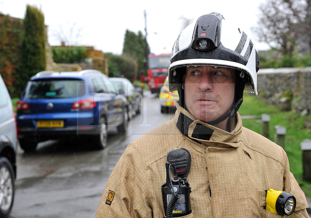 © Licensed to London News Pictures. Date 4 January 2014. Woodstock, Oxfordshire. Mat Carlile Oxfordshire Fire Service. Body  a woman (the householder) in her late 70's, has been found in a fire damaged house that has partially collapsed in Green Lane Woodstock. Photo credit : MarkHemsworth/LNP