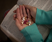 BLACKSHEAR, GA - MARCH 25, 2021: The daily dose of medication and bible verse helps Lisa Martin recover while battling COVID-19. The former schoolteacher underwent a tracheotomy and hung on for weeks in an induced coma, even surviving a stroke. (AJC Photo/Stephen B. Morton)