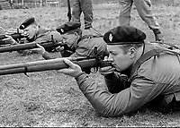 Members of the UDR, Ulster Defence Regiment, undergoing weapons training and shooting practice at Kinnegar Army Camp, Holywood, Co Down, N Ireland, March 1970. 197003000120b<br /> <br /> Copyright Image from Victor Patterson, Belfast, UK<br /> <br /> t: +44 28 9066 1296 (from Rep of Ireland 048 9066 1296)<br /> m: +44 7802 353836<br /> e: victorpattersonbelfast@gmail.com<br /> <br /> www.images4media.com<br /> <br /> Please see my full Terms and Conditions of Use at https://www.images4media.com/p/terms-conditions - it is IMPORTANT that you familiarise yourself with them.<br /> <br /> Images used online incur an additional cost. This cost should be agreed in writing in advance. Online images must be visibly watermarked i.e. © Victor Patterson or that of the named photographer within the body of the image. The original metadata must not be deleted from images used online.<br /> <br /> This image is only available for the use of the download recipient i.e. television station, newspaper, magazine, book publisher, etc, and must not be passed on to a third party. It is also downloaded on condition that each and every usage is notified within 7 days to victorpattersonbelfast@gmail.com.<br /> <br /> The right of Victor Patterson (or the named photographer) to be identified as the author is asserted in accordance with The Copyright Designs And Patents Act (1988). All moral rights are asserted.