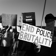 Protesters in Thousand Oaks, CA, demonstrate in support of Black Lives Matter and honoring George Floyd on the day he was buried.