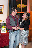 William Davies and Sharon Vaillancourt prepare to get exchange their vows in front of family, friends and patrons at Pitman's Freight Room on Friday evening.  (Karen Bobotas/for the Laconia Daily Sun)